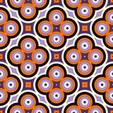 Seamless pattern in Halloween traditional colors. Abstract background with bright geometric ornament. Stock Photos