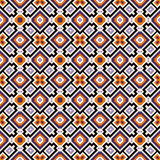 Seamless pattern in Halloween traditional colors. Bright ethnic abstract background. Stock Images