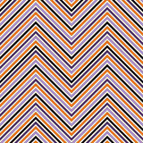 Seamless pattern in Halloween traditional colors. Chevron bright colors diagonal lines abstract background. Stock Photo