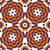 Seamless pattern in Halloween traditional colors. Colorful kaleidoscope decorative round ornament on white background. Royalty Free Stock Photography