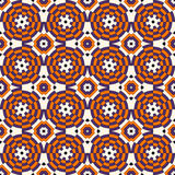 Seamless pattern in Halloween traditional colors. Colorful kaleidoscope decorative round ornament on white background. Ornamental vivid wallpaper. Vector Stock Photos