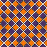 Seamless pattern in Halloween traditional colors. Repeated diamonds background. Checkerboard wallpaper. Seamless pattern in Halloween traditional colors Stock Photography