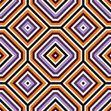 Seamless pattern in Halloween traditional colors. Repeated squares and rhombuses bright ornamental abstract background. Can be used for digital paper, textile Stock Images