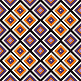 Seamless pattern in Halloween traditional colors. Repeated squares and rhombuses bright ornamental abstract background. Can be used for digital paper, textile Stock Image