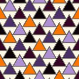 Seamless pattern in Halloween traditional colors. Simple abstract wallpaper with repeated triangles. Seamless pattern in Halloween traditional colors. Repeated Stock Images