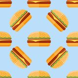 Seamless pattern with hamburger. On blue background. Vector texture Royalty Free Stock Images