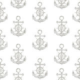 Seamless pattern with hand drawn anchors and steering wheels Royalty Free Stock Photography