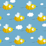 Seamless pattern with hand-drawn bees in the blue sky Stock Image