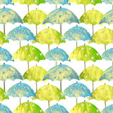 Seamless pattern with hand drawn blue and green umbrellas with white circles on white background. Seamless pattern with hand drawn blue and green umbrellas with Stock Image