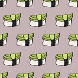 Seamless pattern with hand-drawn cartoon japanese food icon - sushi with avocado. Doodle drawing. Vector illustration  Royalty Free Stock Photography