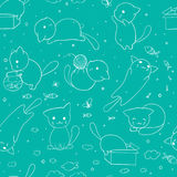 Seamless pattern with hand drawn cats. Blue background vector illustration