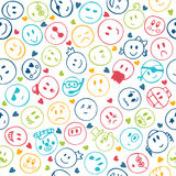 Seamless pattern of hand drawn colorful smiley funny faces Royalty Free Stock Images