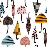 Seamless pattern with hand drawn colorful umbrellas. Childish texture. Great for fabric, textile Vector Illustration. Seamless pattern with hand drawn colorful Stock Photos