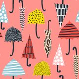 Seamless pattern with hand drawn colorful umbrellas. Childish texture. Great for fabric, textile Vector Illustration.  Royalty Free Stock Image