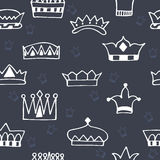 Seamless pattern with hand drawn crowns on dark background Stock Photography