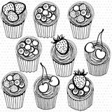 Seamless pattern with hand drawn cupcakes on a polka dot backgro Royalty Free Stock Image