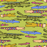Seamless pattern with hand drawn cute doodle crocodiles Stock Image
