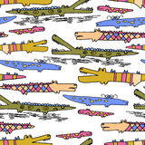 Seamless pattern with hand drawn cute doodle crocodiles. Seamless pattern with bright hand drawn cute doodle crocodiles Stock Photography