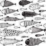 Seamless pattern with hand drawn cute fish in sketch style. stock photos