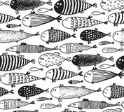 Seamless pattern with hand drawn cute fish in sketch style. royalty free illustration