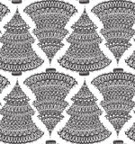 Seamless  pattern with hand drawn doodle christmas trees Royalty Free Stock Images