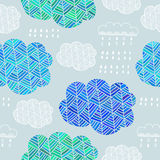 Seamless pattern of hand drawn doodle clouds Royalty Free Stock Photo