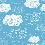 Seamless pattern of hand drawn doodle clouds Stock Photo