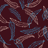 Seamless pattern with hand drawn feathers on dark red background Royalty Free Stock Photography