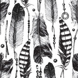 Seamless pattern with hand drawn feathers Stock Photos