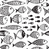 Seamless pattern with hand drawn funny fishes in sketch style. Vector decorative endless marine background. Fabric design Stock Images