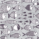 Seamless pattern with hand drawn funny fishes in sketch style. Royalty Free Stock Image