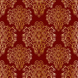Seamless pattern with hand drawn golden ornament on a red background Stock Photo