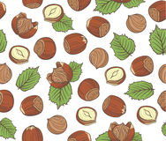 Seamless pattern with hand drawn hazelnuts on white background. Stock Photo