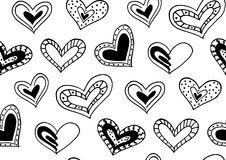 Seamless pattern with the hand drawn ink doodle hearts. Stock Photography
