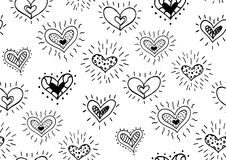 Seamless pattern with the hand drawn ink doodle hearts. Royalty Free Stock Image