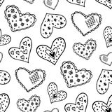Seamless pattern with the hand drawn ink doodle hearts. Royalty Free Stock Images