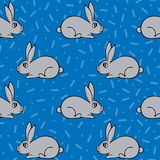 Seamless pattern with hand-drawn lovely hares. Seamless pattern with hand-drawn lovely hares on the blue background Stock Photography