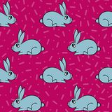 Seamless pattern with hand-drawn lovely hares. Seamless pattern with hand-drawn lovely hares on the pink background Stock Images