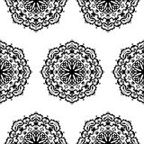 Seamless pattern with hand drawn mandalas Stock Images