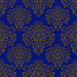Seamless pattern with hand drawn ornament on a blue background. Royalty Free Stock Photos