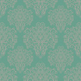 Seamless pattern with hand drawn ornament on a green background Stock Photo