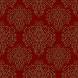 Seamless pattern with hand drawn ornament on a red background Royalty Free Stock Photo