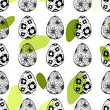 Seamless pattern with hand drawn ornamental eggs and colorful scattered confetti. Stock Images