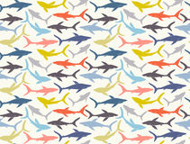 Seamless pattern of hand-drawn sharks silhouettes stock illustration