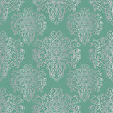 Seamless pattern with hand drawn silver ornament on a green background Stock Image
