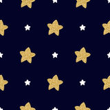 Seamless pattern with hand drawn white and golden stars on a dark background. Royalty Free Stock Images