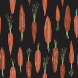Seamless pattern with hand painted carrots. On black background. Great for agriculture, restaurant, cafe, grocery, food ads, texture design Stock Photography