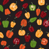 Seamless pattern with hand painted peppers. On black background. Great for agriculture, restaurant, cafe, grocery, food ads, texture design Royalty Free Stock Photography