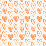 Seamless pattern of hand-painted red hearts Stock Image