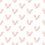 Seamless pattern with handdrawn hearts background made with brush. Expressive romantic hand drawn hearts. Stock Photo